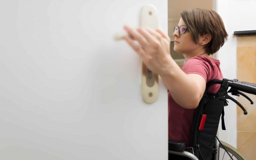 disabled woman at the open door with space