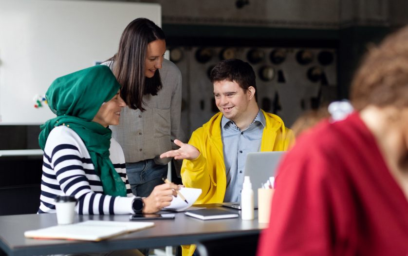 Down syndrome man consulting with women