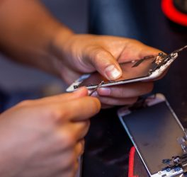 A man is repairing a mobile phone